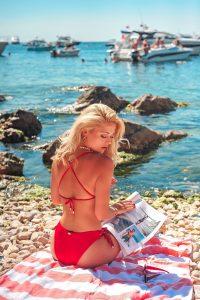 15% off cosmetic surgery -beach body - woman on beach in bikini